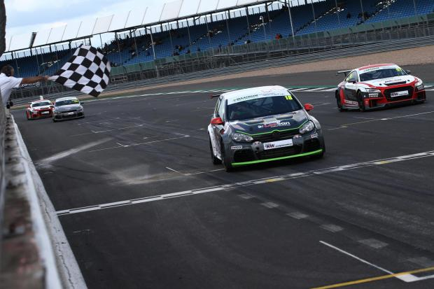 Northwich Guardian: Mark Wakefield crosses the line ahead of Owen Walton behind the wheel of his HGS Sport-prepared Golf during the opening race of the Volkswagen Racing Cup's third round at Silverstone. Picture: Jakob Ebrey Photography